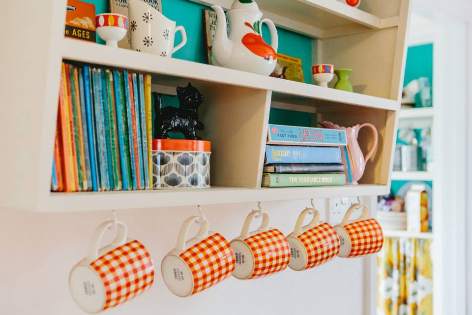 Pretty revamped cupboard with cuphooks and vintage touches
