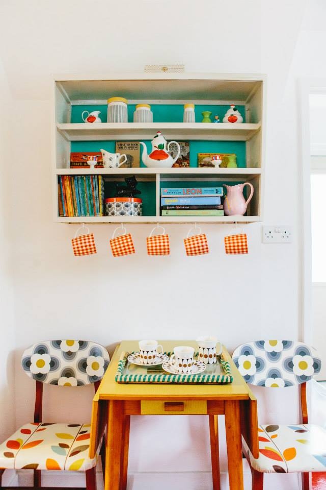 a house tour of this fantastic renovated cottage using retro, upcycled and vintage pieces - pretty kitchen setting with retro pieces