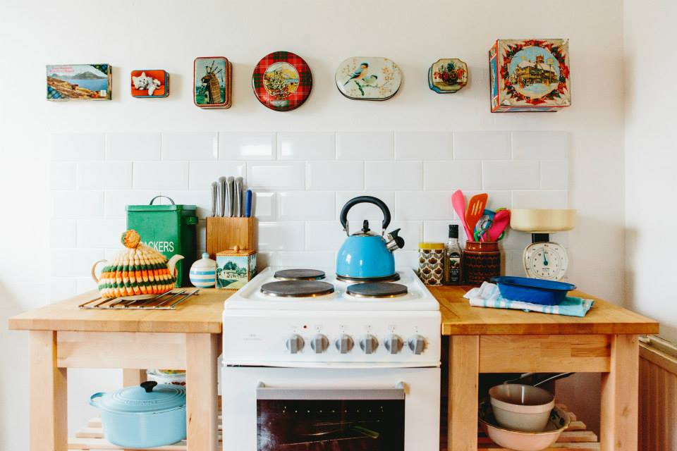 Beautiful kitchen renovation using vintage and recycled items such as the tins, cooker and side tables
