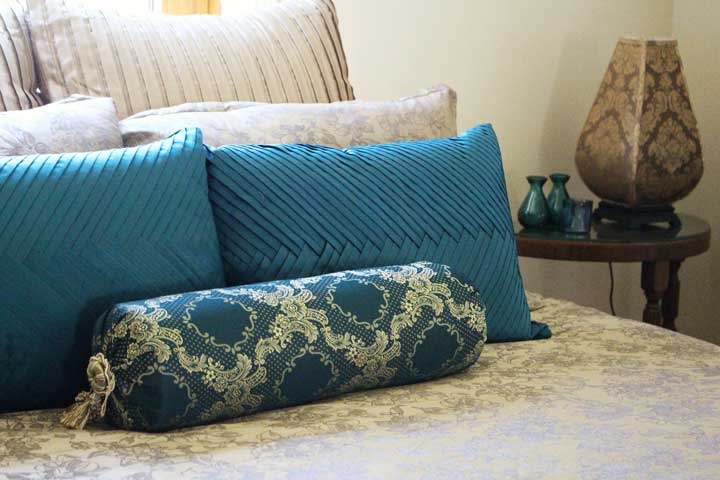 Side tables and lamps for loft guest room sourced from garage sales and secondhand stores