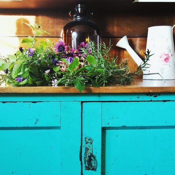 Painted cupboard and flowers, vintage bottles - house tour of my boho home