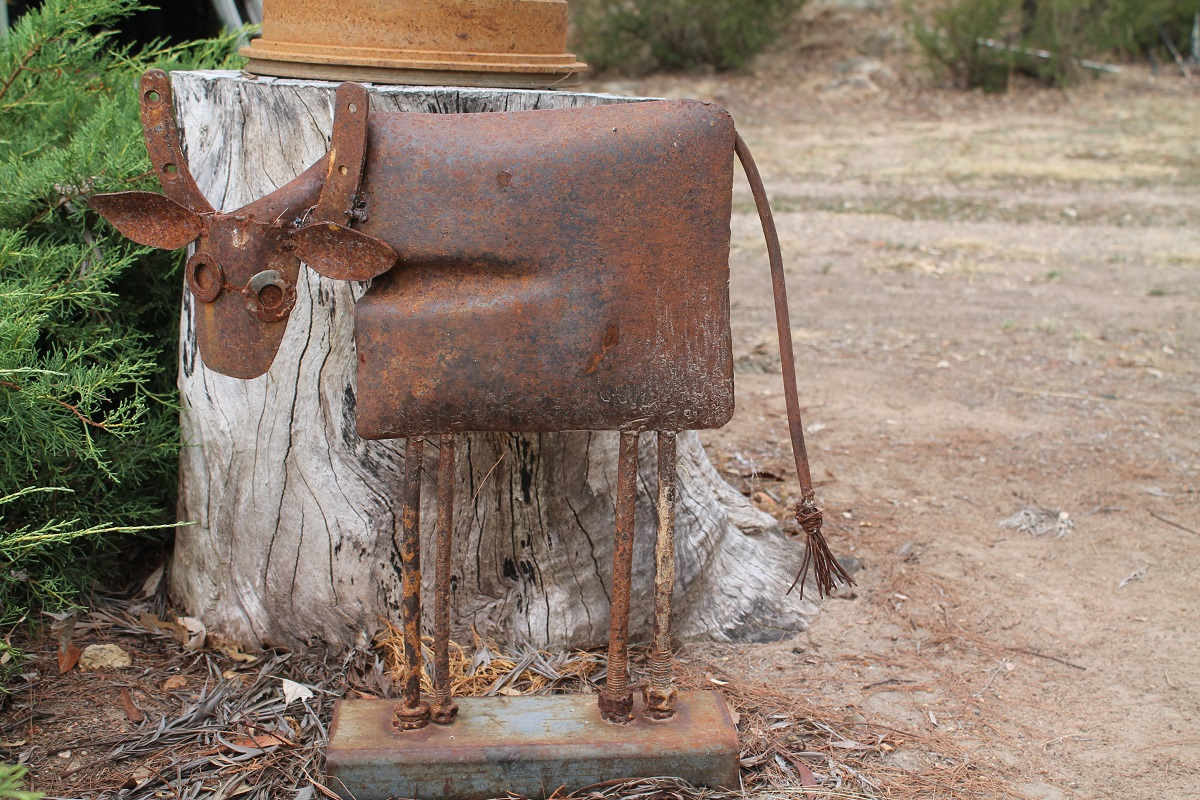 upcycled rusty cow made from recycled metal